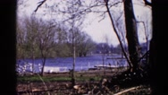 1960: view of lake and several docks in the fall with wind blowing Stock Footage