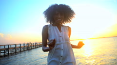 Portrait of young slim attractive African American female wearing Hipster style Stock Footage