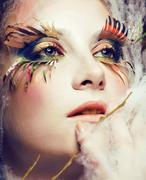 Woman with creative make up closeup like butterfly, summer trend big lashes Stock Photos