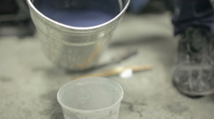 The varnish poured from a bucket into the glass Stock Footage