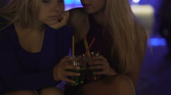 Pretty female talking to upset disappointed friend at party, supportive person Stock Footage