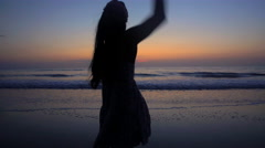 Silhouette of young slim attractive Asian Indian female wearing Hipster style Stock Footage