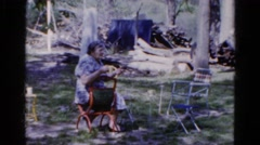 1960: elderly woman carries on conversation with person outdoor  Stock Footage