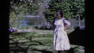 1960: woman is seen posing WAUCONDA, ILLINOIS Stock Footage