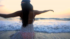 Young attractive Indian American girl enjoying leisure and dancing barefoot  Stock Footage