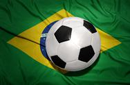 Black and white football ball on the national flag of brazil Stock Photos