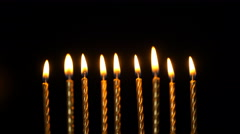 Footage golden burning candles set on black background. 4K Stock Footage