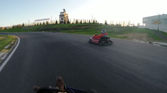 Two drivers go on karts showing thumbs up Stock Footage