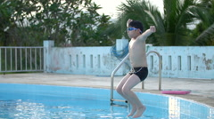 Slow motion of asian child playing in pool, Happy boy having fun on vacation. Stock Footage