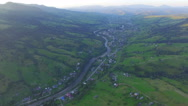 The village in a mountain valley. aerial view Stock Footage