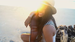 Young cute Indian American female in Hipster style sundress relaxing  Stock Footage