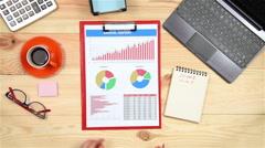 Analyzes Financial Charts Stock Footage