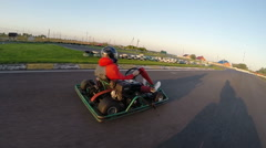 Man drives go kart on track Stock Footage