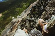 Mans legs on the top of mountain. First person view Stock Photos
