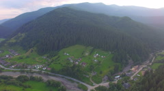 Village near the mountain. aerial view Stock Footage