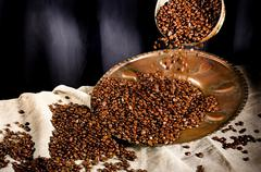 Coffee in grains is used for preparation of a popular and fragrant drink Stock Photos