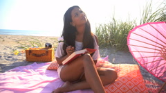 Young slim Asian Indian woman in Retro style sundress relaxing with picnic set Stock Footage