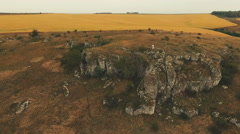 Aerial view of golden rocks and fields Stock Footage