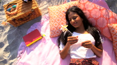 Young happy Indian American female in Retro style sun dress chilling  Stock Footage
