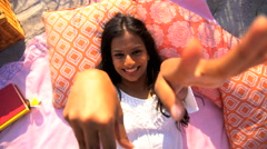 Portrait of beautiful cute Indian American woman enjoying picnic making video Stock Footage