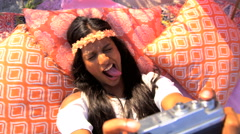 Young smiling Indian American female in hippie style sundress taking selfie  Stock Footage