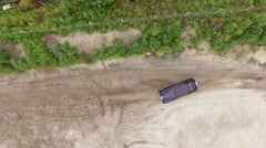 Aerial footage. Vintage car driving on a sandy shore. Vertical view with rotate. Stock Footage
