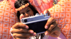 Young happy smiling Indian American woman enjoying picnic making video diary  Stock Footage