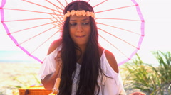 Young attractive cute Indian American girl with parasol enjoying picnic  Stock Footage
