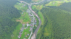The forest around the village. aerial footage Stock Footage