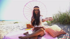 Portrait of young attractive Indian American girl with parasol making video Stock Footage