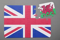 Puzzle with national flag of Great Britain  and Wales piece detached. Stock Photos