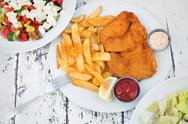 Food with potatoes, chicken schnitzel and salads Stock Photos