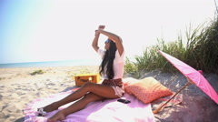 Attractive Asian Indian girl in Retro style clothing relaxing at picnic  Stock Footage
