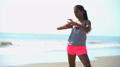 Young fit Indian American girl enjoying training and checking sport watch  Stock Footage