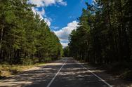 Summer empty road going through the pinery in Burabai Nature National park Stock Photos