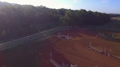 Pull Away from Central Texas Equestrian Arena at Sunrise by Drone Stock Footage