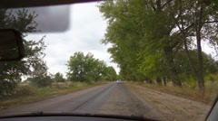 Driving a car on countryside. POV from windshield. Stock Footage