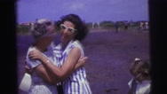 1967: younger woman greets older woman at airport before helping with bags Stock Footage
