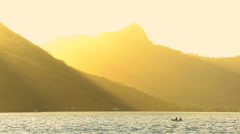 Bora Bora Island and Mt Otemanu in French Polynesia a view at sunrise with sun Stock Footage