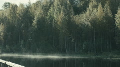 Rural landscape with fog on the water near old wooden jetty Stock Footage