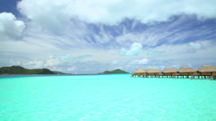 View of Mt Otemanu and tropical holiday resort with luxury Overwater Bungalows Stock Footage