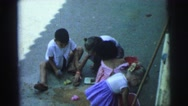 1967: kids playing together with buckets and shovels in the sand having fun. Stock Footage