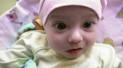 Newborn baby with big brown eyes looking around Stock Footage
