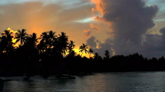 Cloudscape view at sunset of tropical Bora Bora Island lagoon and Palm trees Stock Footage