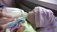 Newborn baby feeding from baby bottle Stock Footage