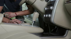 Car detailing series. Young man cleaning car interior Stock Footage