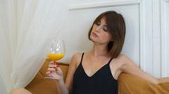 Gorgeous woman drinking orange juice in luxury bedroom slow motion Stock Footage
