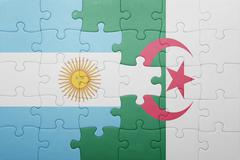 Puzzle with the national flag of algeria and argentina Stock Photos