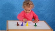 Adorable toddler girl with curly hair painting with crayons on paper sitting Stock Footage