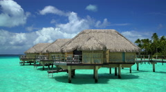 View of tropical holiday resort with luxury Overwater Bungalows in Bora Bora a Stock Footage